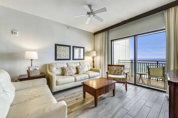 Living Room w/ Sleeper Sofa (sleeps 1-2) + Balcony view