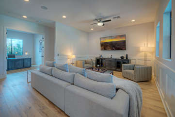 Feel comfortable in luxurious family room with large television