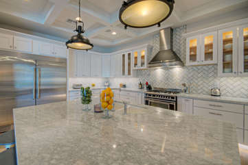 What chef won't love working in this elegant kitchen stocked with every culinary tool imaginable?