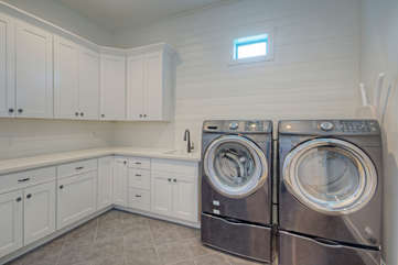 A laundry room complete with everything you require to stay ahead of your wardrobe needs