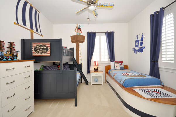Bedroom 6 is a pirate themed room featuring a Pottery Barn Camp Twin-Over-Full bunkbed and an additional twin boat bed