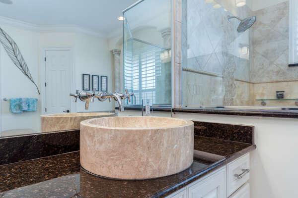 Large granite sink at the vanity