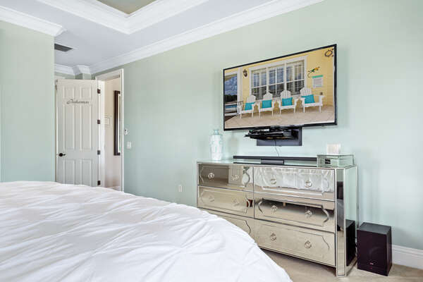 Watch TV on the 60-inch SMART TV while relaxing in bed