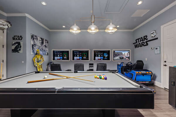 Step into the galactic themed games room with a driving simulator arcade, 3 gaming consoles, and 4x50-inch SMART TVs