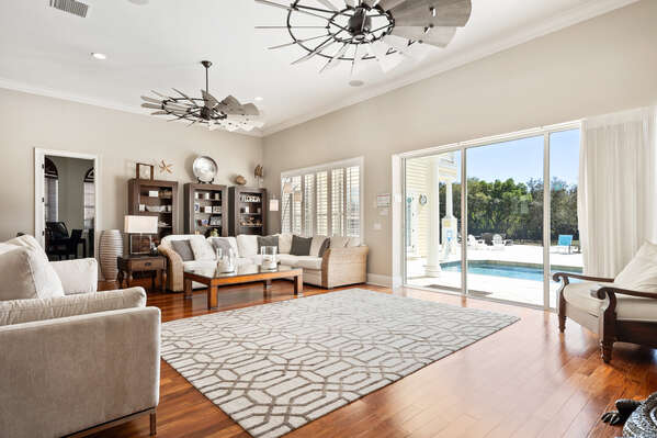 Large triple sliding patio doors gives awesome views of the deck and golf course