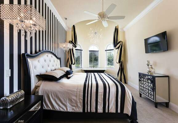 Divine black and white bedroom with an accent wall