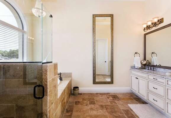 Ensuite bathroom with glass shower and granite counter