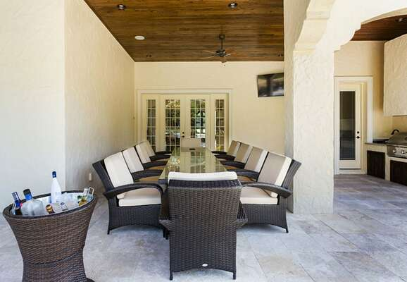 Enjoy your outdoor oasis complete with ample seating and summer kitchen