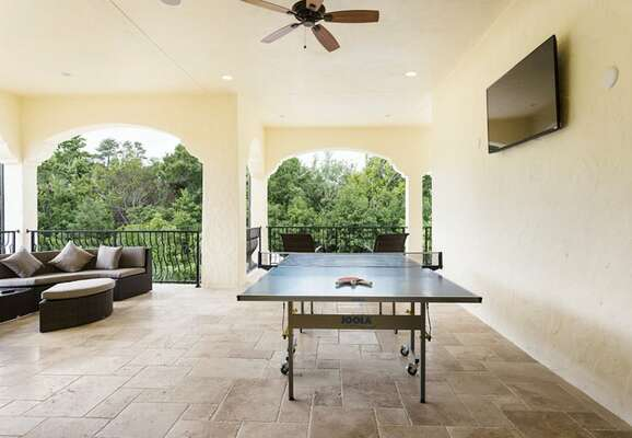 The balcony has an HDTV, table tennis and luxury lounge furniture
