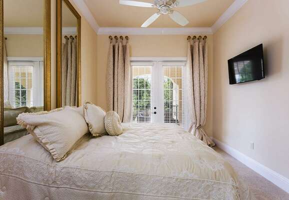Sleep easy in this king bedroom with overhead ceiling fan and HDTV