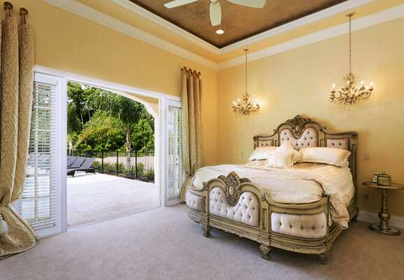 Royal inspired bedroom with crystal chandeliers and a luxurious king bed