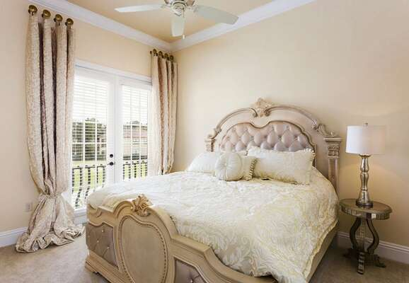 This second floor bedroom has French doors out to the balcony