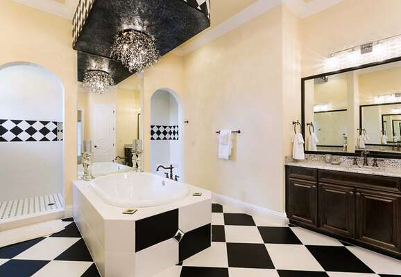 Emaculate back and white bathroom with large soaking tub and shower space