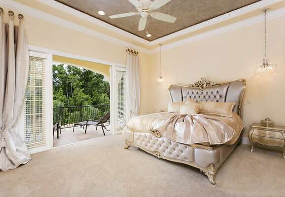 Second floor king bedroom with French doors out to the balcony
