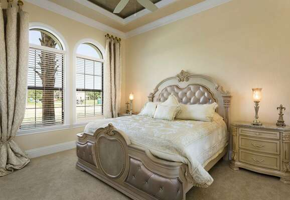 Ground floor king bedroom with a ceiling fan