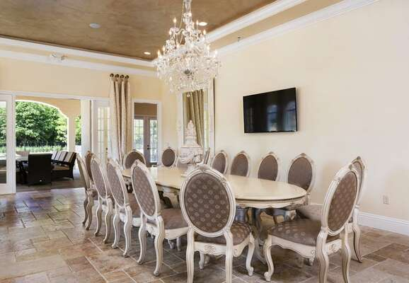 The formal dining table under a gorgeous crystal chandelier