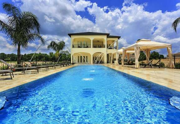 Miami style pool area with cabanas and a south facing pool