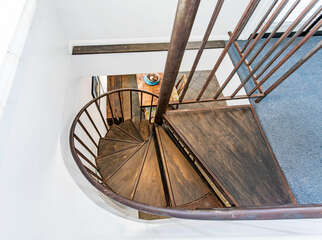 Spiral staircase leading downstairs.