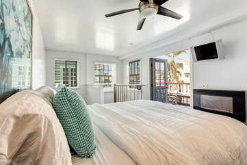 Master bedroom view through French doors to private balcony!