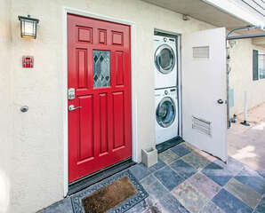 Private laundry closet with access by front door.