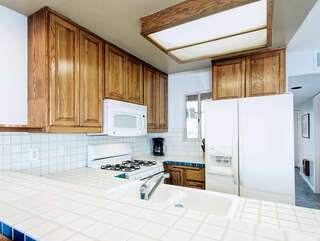 Kitchen with tiled counter top
