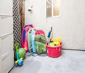 Beach gear stored in 2nd patio with access from the downstairs hallway.