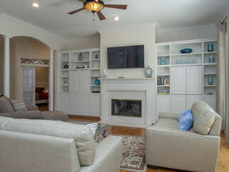 Living room area with HDTV and access to the deck