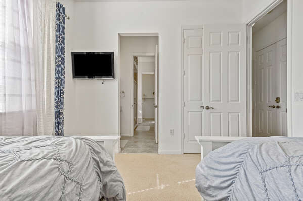 Featuring a TV and ensuite bathroom