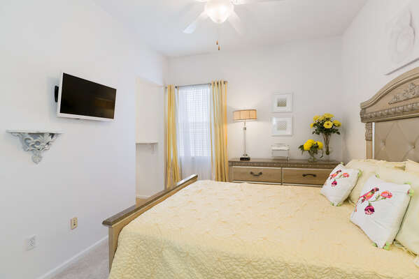 Watch TV and relax in this bedroom