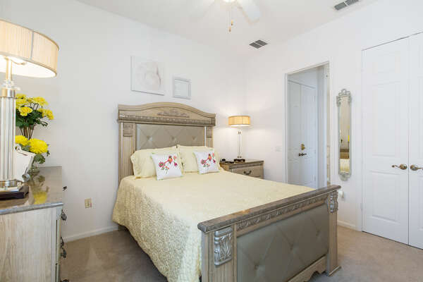 This bedroom features a full bed and elegant decor