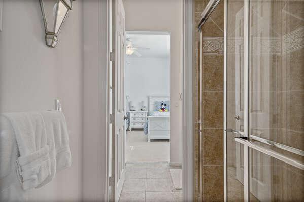 The bathroom has a walk-in shower