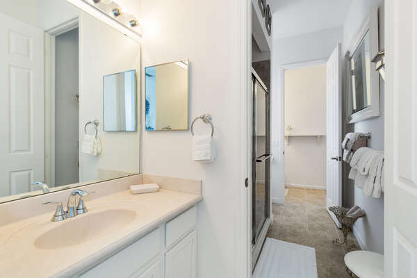 A Jack and Jill bathroom connects two bedrooms