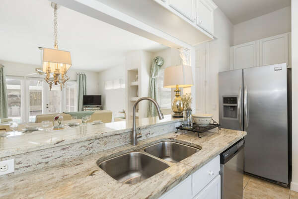 With upgraded stainless steel appliances and granite countertops, this modern kitchen is great for making meals on vacation