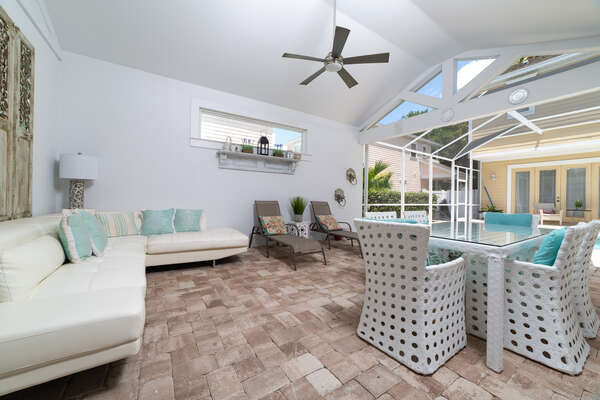 Relax on comfortable patio furniture underneath the covered lanai