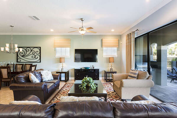 Plush living area is perfect for the whole family to relax together and watch a TV show