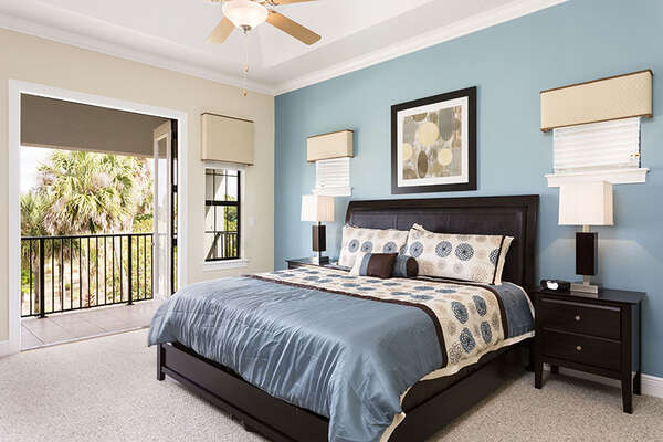 This bedroom also features a private balcony overlooking the Jack Nicklaus golf course