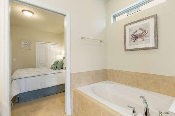 En suite bathroom with walk in shower and separate bathtub