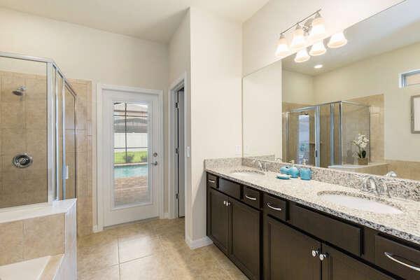En suite bathroom has private access to the patio