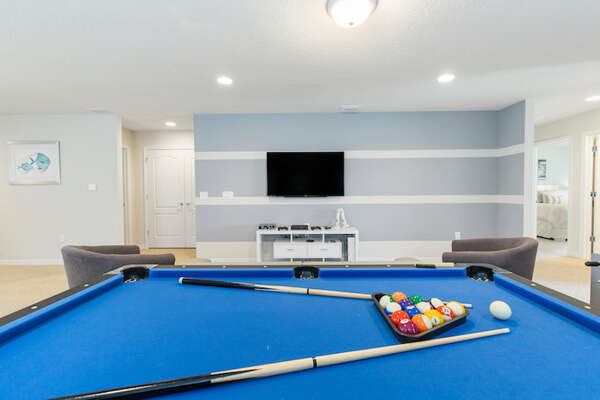 Challenge someone to a game of pool or sneak in a practice round