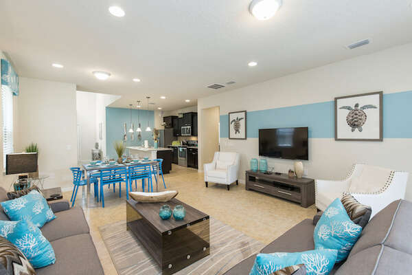 The living room has a large screen TV perfect for family movie time