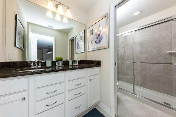 En-suite bathroom with a walk-in shower