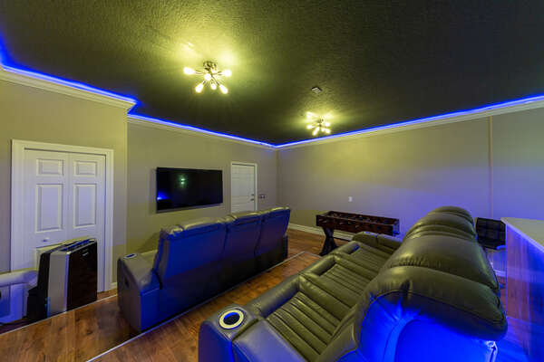 Relax and enjoy the media room with comfortable recliners