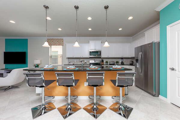 Take a seat at the kitchen bar for a snack or breakfast