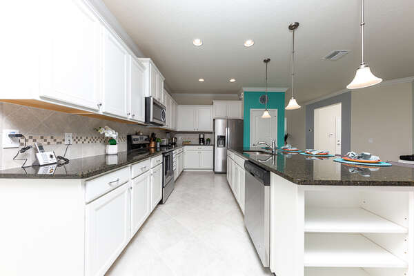 A large kitchen space with all of the appliances included