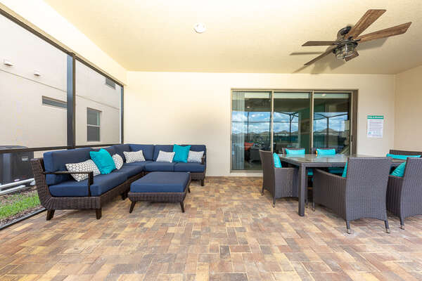 A beautiful covered outdoor patio with plenty of comfortable seating