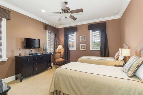 This bedroom features two twin beds, perfect for a good night of sleep before a day of vacation adventures