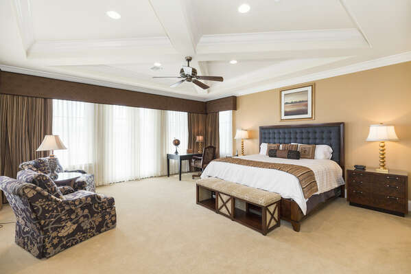This spacious master suite features a King bed and plenty of space to relax