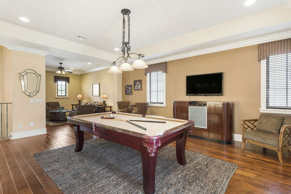 Play a game of pool and watch a show in the gorgeous second floor loft
