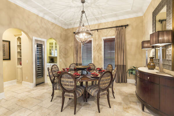 The formal dining nook has a round table for 8 guests