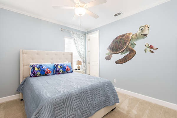 Everyone will love this queen bedroom with fun details